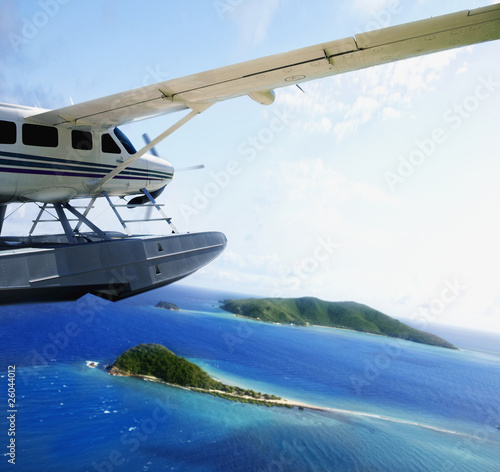 Sea plane flying over water