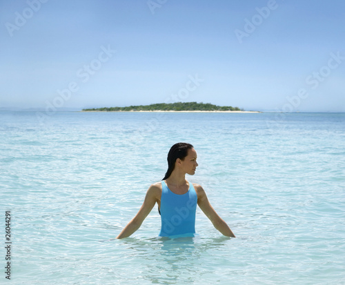 Pacific Islander woman in ocean