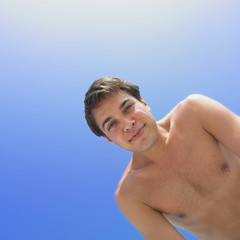 Low angle view of man with bare chest