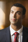 Hispanic businessman looking up