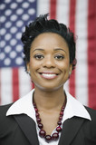 African businesswoman standing near American flag