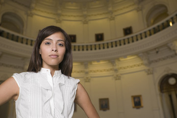 Hispanic businesswoman in capitol building