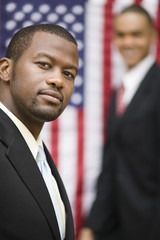 African businessmen standing near American flag