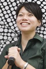 Asian woman carrying umbrella