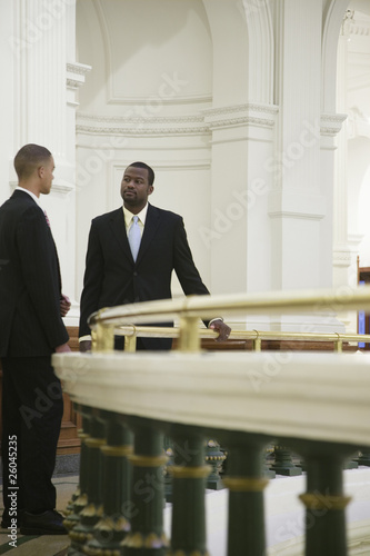 African businessmen talking near railing