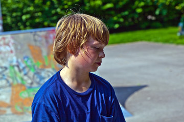 portrait of young boy sweating after sports