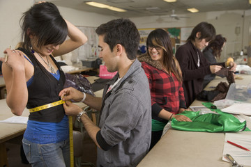 Fashion design students designing clothing