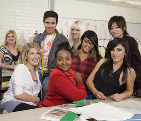 Portrait of fashion design students in classroom