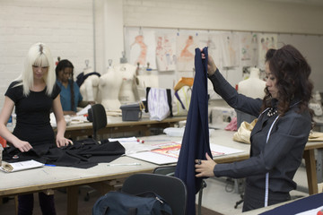 Fashion design students working in classroom