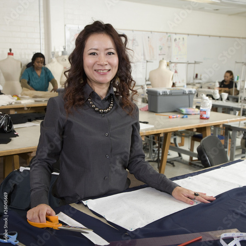 Asian fashion design student working in classroom