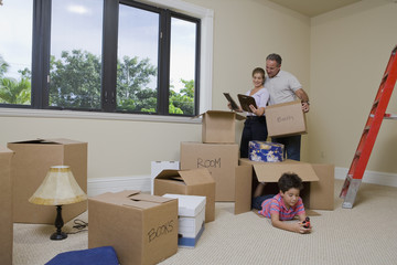 Hispanic family in living room with cardboard boxes