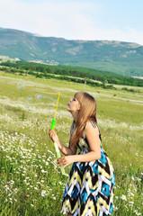 blowing teen girl