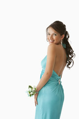 Hispanic girl in evening gown ready for prom