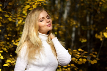 An attractive girl in the autumn forest