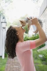 Mixed race teenage girl holding dog