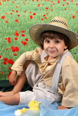 a boy in rural attire at the Flower Field