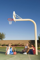 Men relaxing after playing basketball