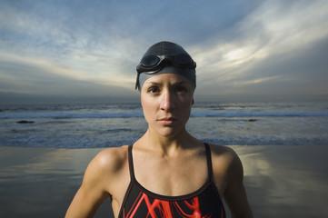 Hispanic woman in bathing suit on beach
