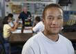 African American student posing in refrigeration technician classroom
