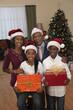 African couple with grandchildren in santa hats