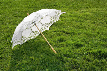 White elegant umbrella on fresh grass