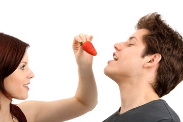 young beautiful couple with a strawberry (white background)