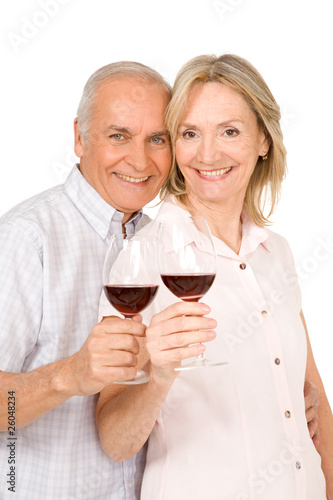 Nice senior couple with glasses of wine