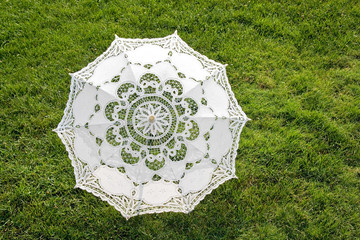 Beautiful sun umbrella on the green lawn