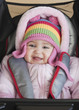 Mixed race baby girl bundled up in winter coat