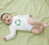 Mixed race baby girl with recycling symbol on shirt