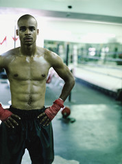 African boxer standing in gymnasium