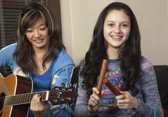 Teenage girls playing instruments