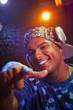 Hispanic dj in headphones pointing