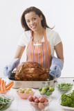 Hispanic woman preparing Thanksgiving dinner