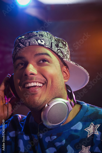 Hispanic dj listening to headphones