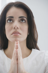 Hispanic woman praying