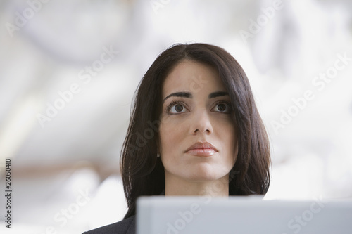Hispanic businesswoman working at desk