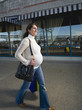 Pregnant Middle Eastern woman carrying shopping bags
