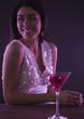 Hispanic woman drinking cocktails