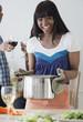 African woman preparing dinner