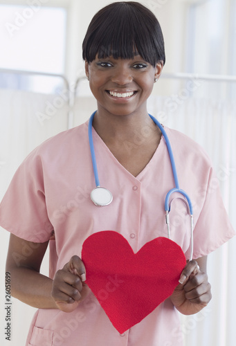 African nurse holding heart-shaped piece of paper