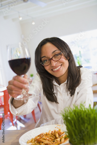 Mixed race woman enjoying wind in cafe