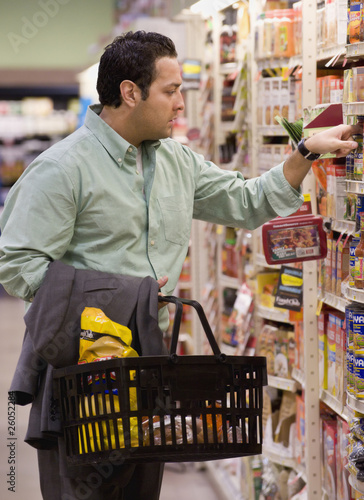 Hispanic man shopping in grocery store