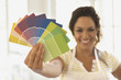 Hispanic woman choosing paint color