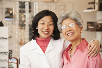 Korean optician standing with customer