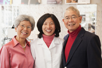 Korean optician standing with customers