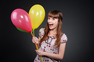 carefree girl with balloons
