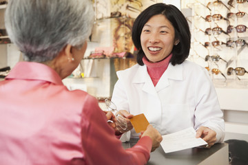 Korean optician talking to customer