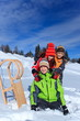 Children with sledge in Winter