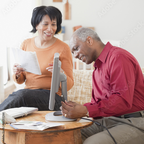African couple assembling computer